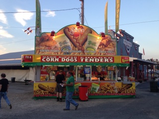 Sivori Corn Dog and Chicken Tenders Concession Stand in the Evening with the Lights Turned on.