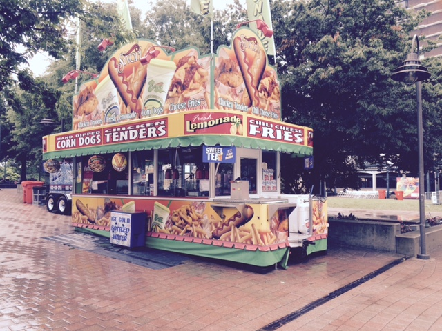 Sivori Catering Concession Stand Showcasing Corn Dogs and Chicken Tenders on a Rainy Day.